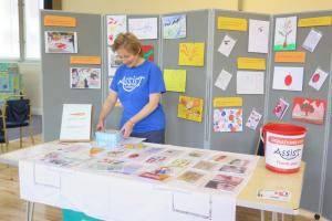One of our volunteers selling cards at a recent event